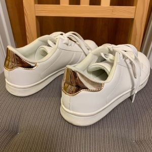 White sneakers with gold heel
